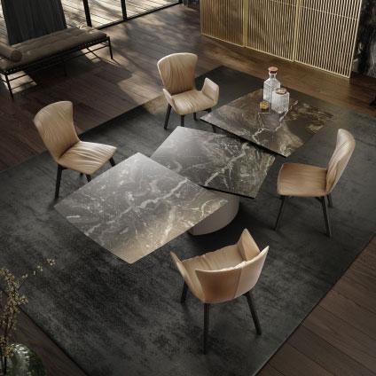 draenert adler, de tafel die in no time van klein naar groot kan worden verlengd, in natuursteen of hout,centrale sokkel in metaal